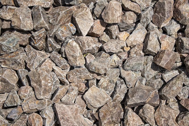 Background from fragments of granite stones close up stock photos