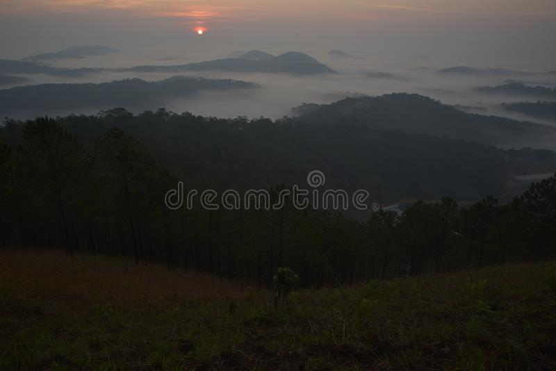 Background with fresh air, magic light and dense fog cover forest in the plateau at dawn part 4 royalty free stock image