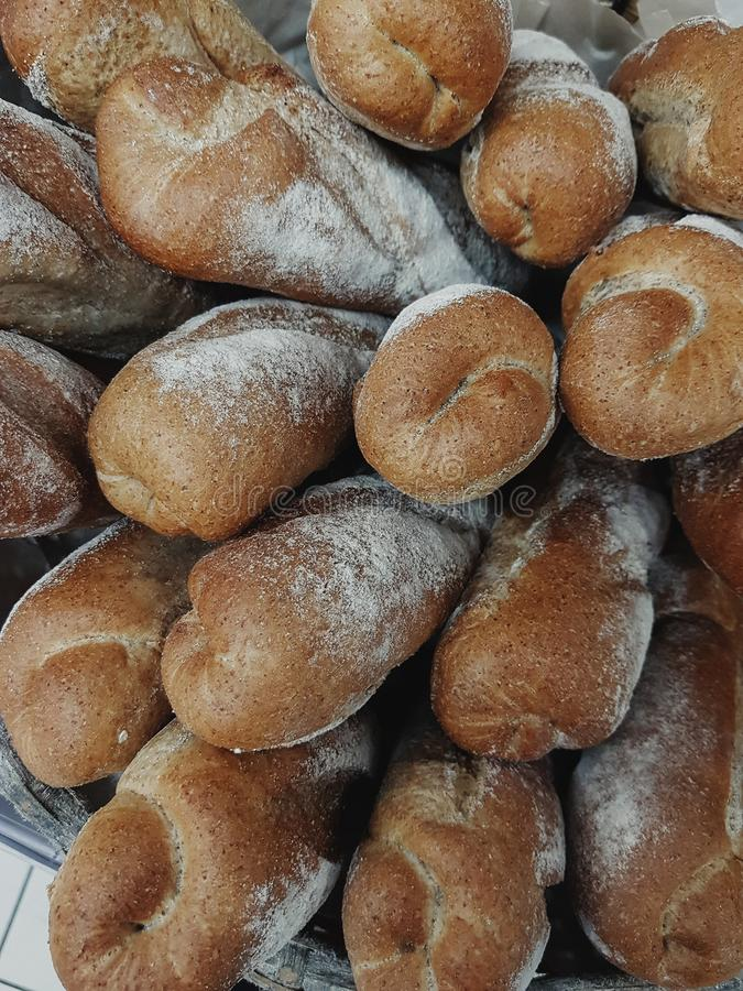 Background of fresh french baguettes in bakery royalty free stock photo