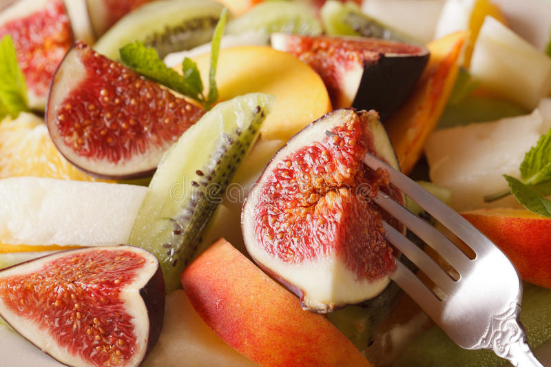 Background of fresh fruit salad with fig, peach, melon, kiwi and stock images