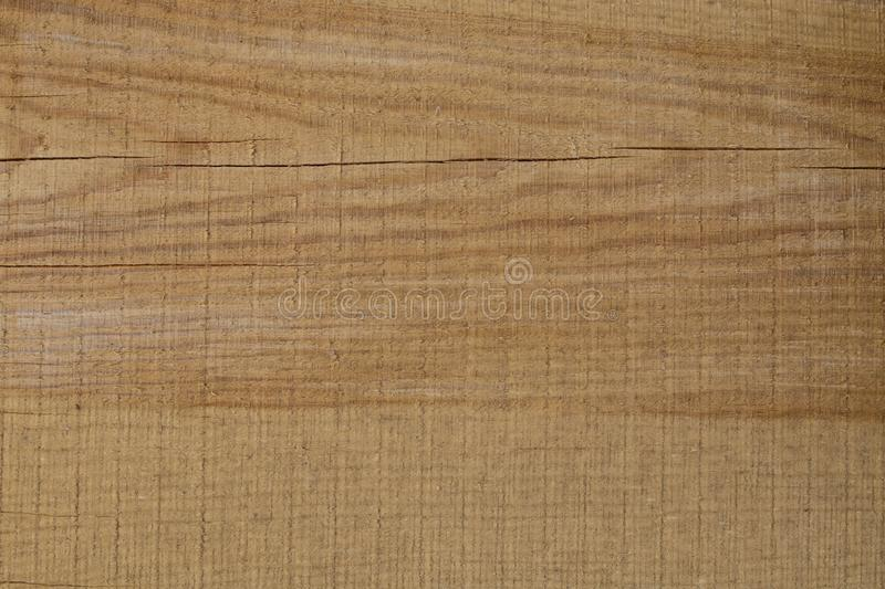 Background of freshly cut brown wooden boards with cracks stock images