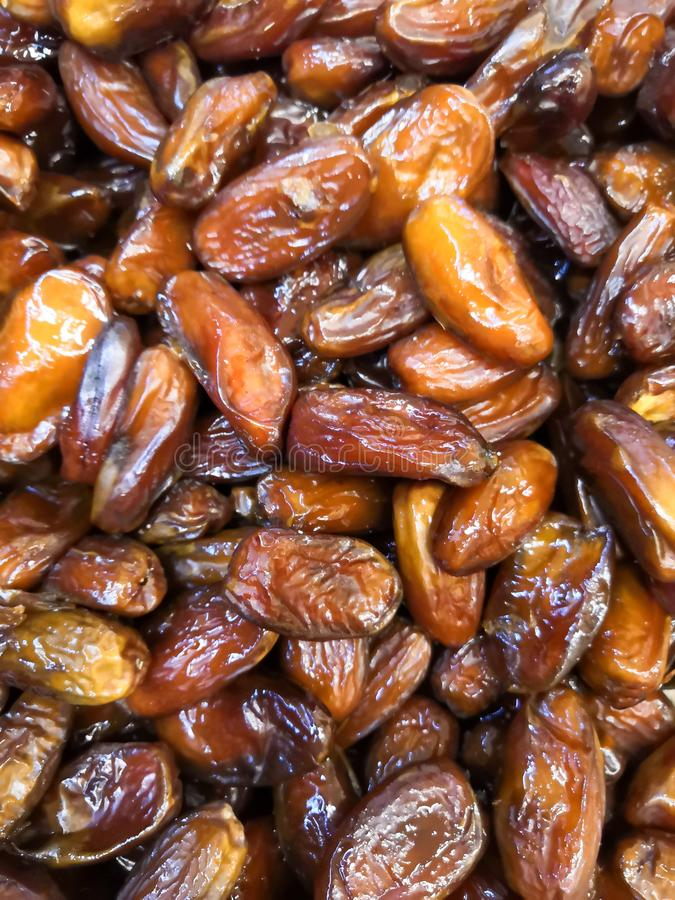 Background from the fruit of the date palm. Dried date a lot of background royalty free stock photo