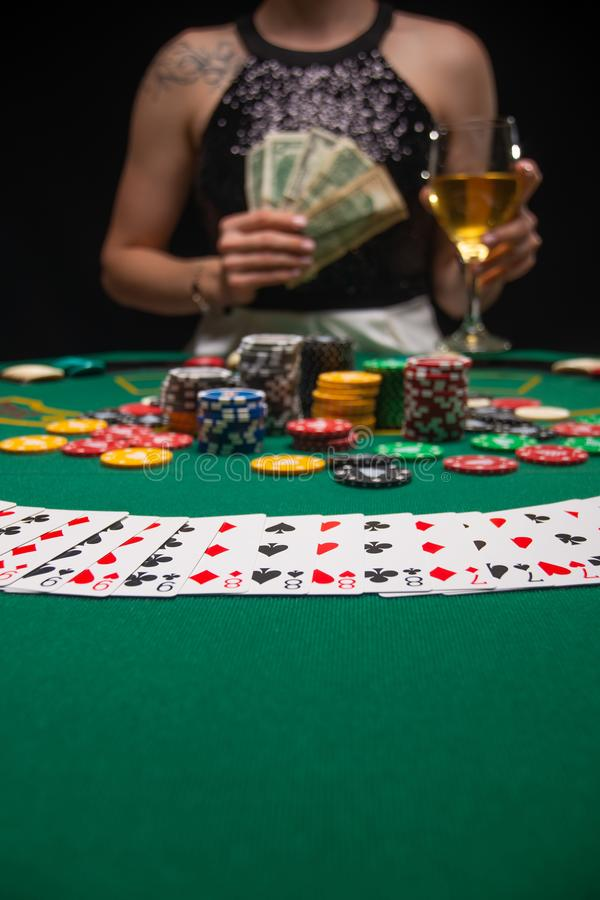 Background of a gaming casino, poker tables, cards, chips and a girl with a glass of wine. Background for a gaming business,. Success, Vertical photo royalty free stock photos