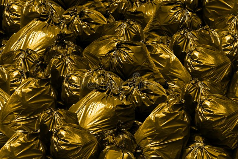 Background garbage dump Pollution Garbage bags with yellow and gold, Bin,Trash, Garbage, Rubbish, Plastic Bags pile royalty free stock photo