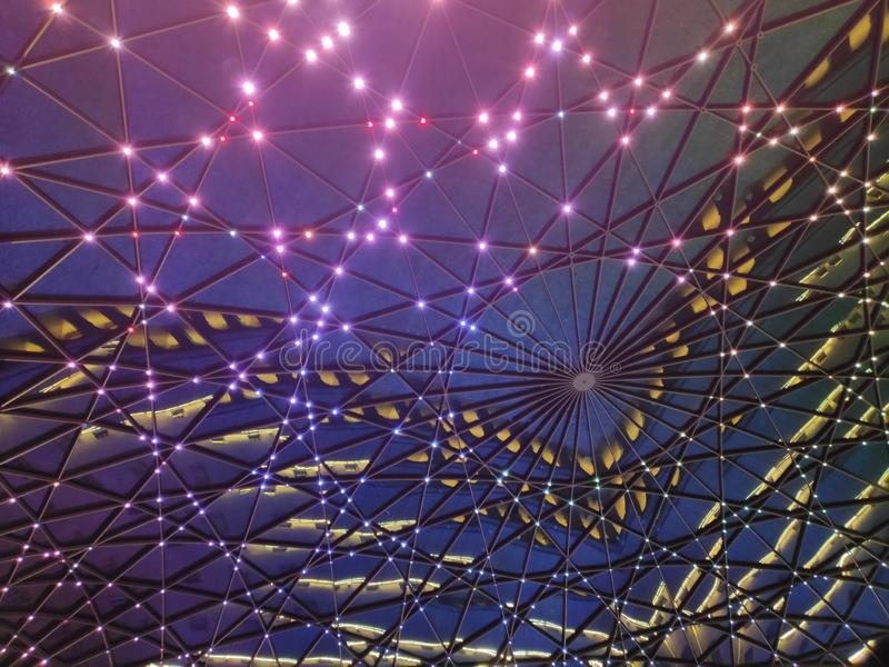 Background of geometric dome at night with lights royalty free stock photography