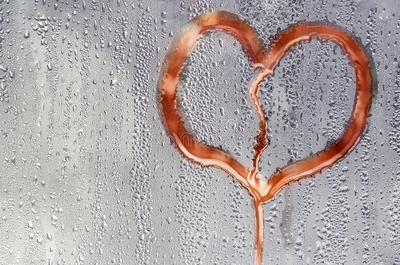 Background on the glass with drops and the heart stock photos