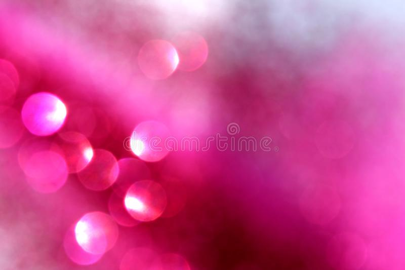 Texture shiny background pink color christmas mood. Background, glitter, light, abstract, bokeh, christmas, shiny, lights, decoration, texture, sparkle, holiday royalty free stock photo