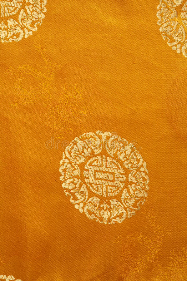 Background from a gold chinese fabric royalty free stock image