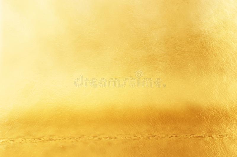 Background of gold foil texture with light reflections.  stock photography