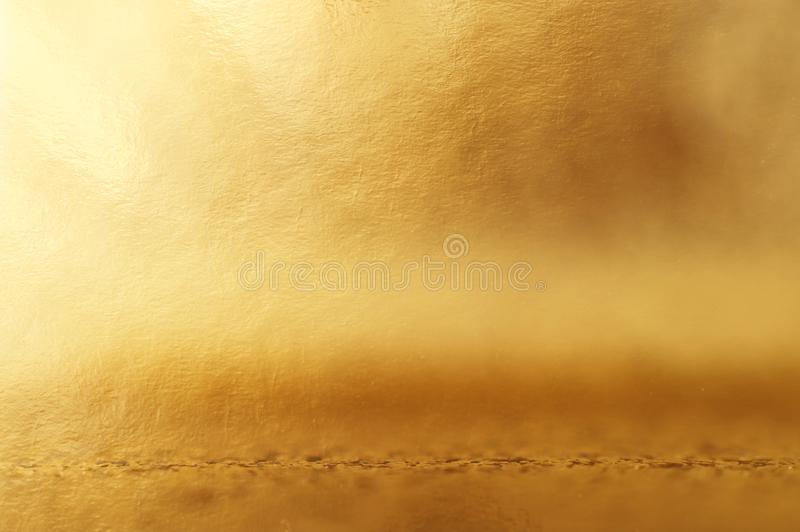 Background of gold foil texture with light reflections.  stock photos