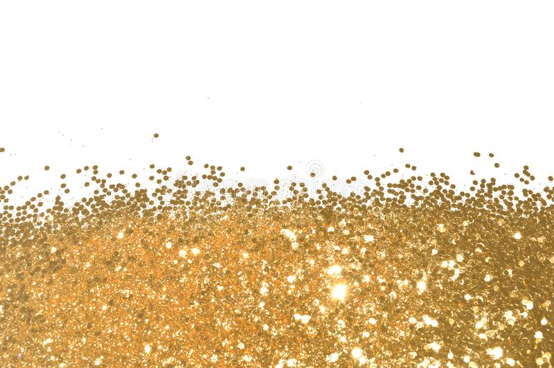 Background with gold glitter sparkle on white, decorative spangles royalty free stock photos