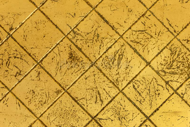 Golden aged tiles. Background of Golden aged tiles, close-up stock images