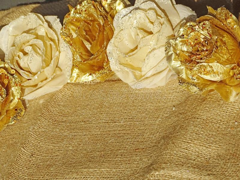 Background of golden flowers. Background of golden and white flowers on cotton texture stock images