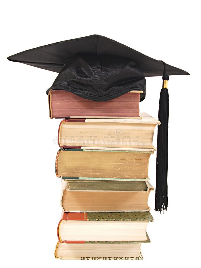 Graduation Cap and Books. A background of a graduation cap and books isolated on white royalty free stock images