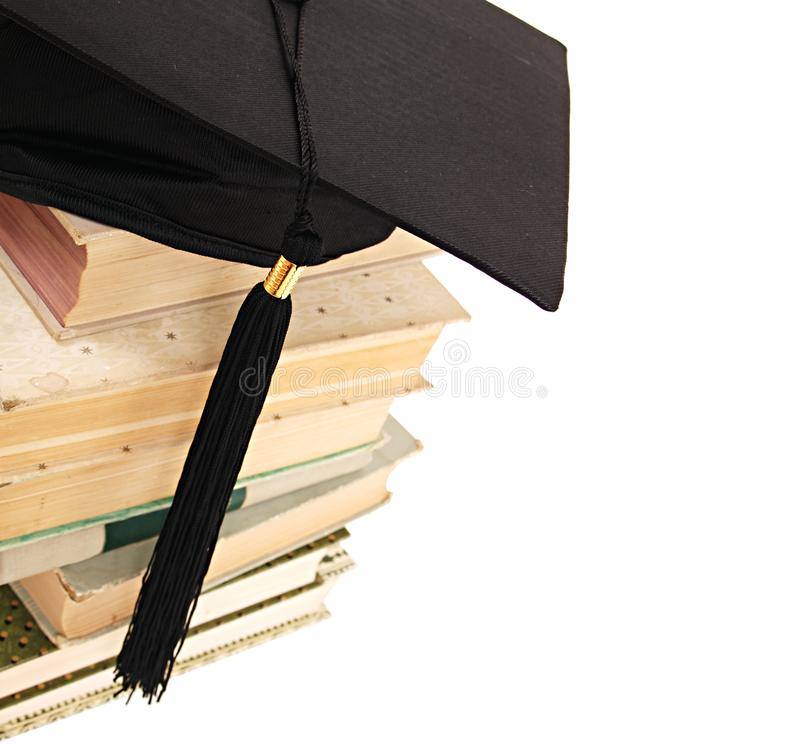 Graduation Cap and Books. A background of a graduation cap and books isolated on white stock photography