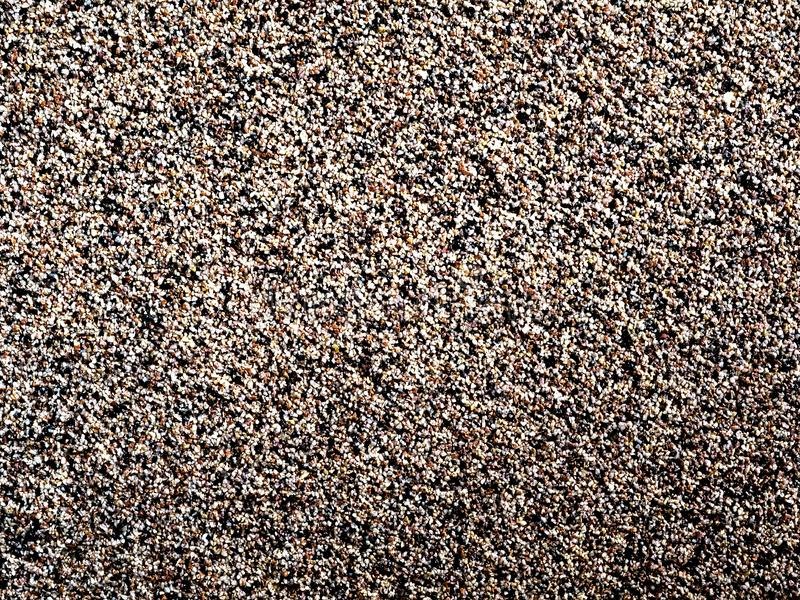 Background of grains, stones, pebbles, brown and black. Abstract bright background with dots royalty free stock photography