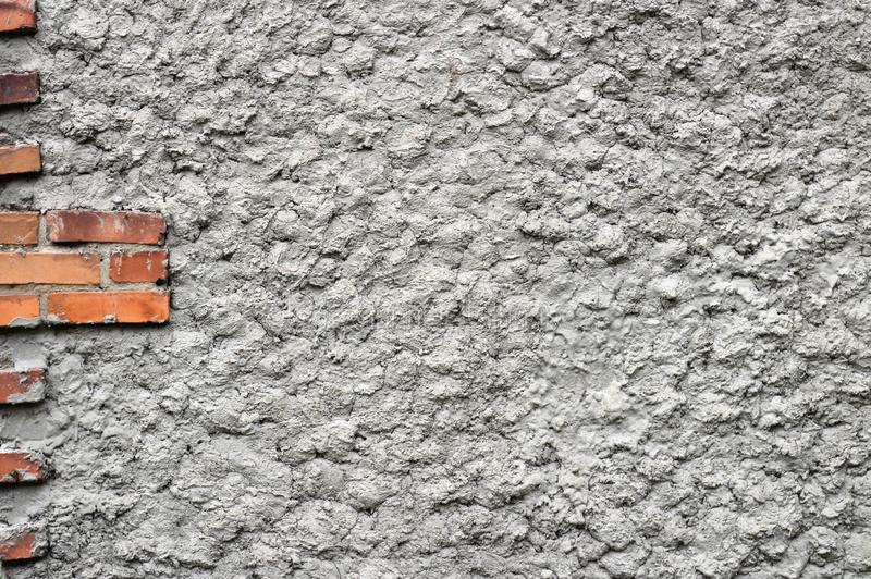 background of gray concrete wall with red bricks stock photography