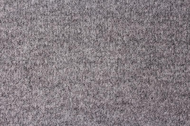 Background of grey knitted fabric. Home made stitchwork. stock photography