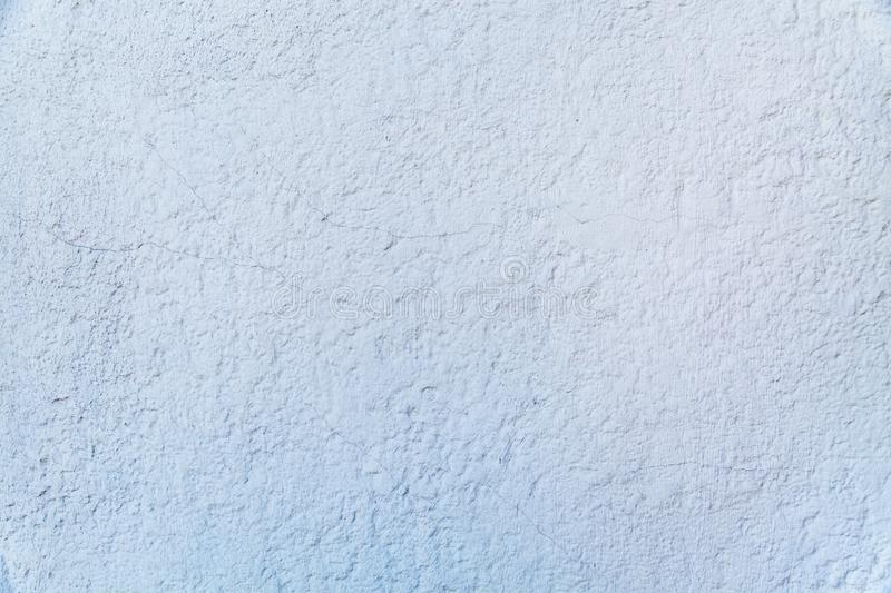 Background of grey painted embossed wall with cracked rough finish. Backgrounds texture design royalty free stock photos