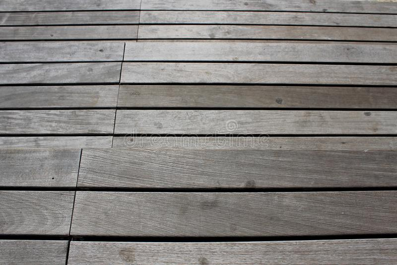 A background of a grey wooden parallel lanks royalty free stock photos