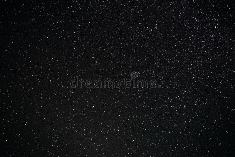 Background of grizzle and blue starry night sky.  royalty free stock photography