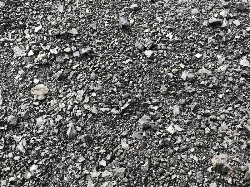 Tiny pieces of Coal background. Background of ground pieces of coal near entrance to abandoned coal mine, Rosyln, Washington, USA in the foothills of the Cascade royalty free stock photo