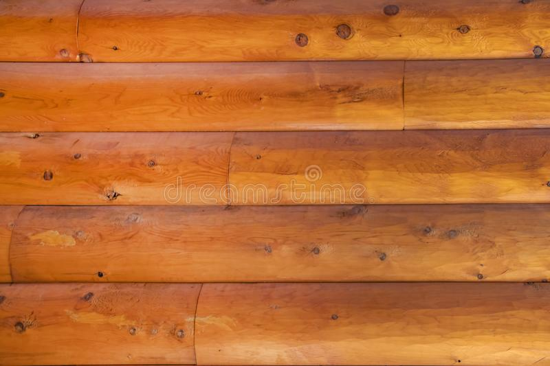 Background of hewn log cabin wall - closeup with lots of knotholes and grain royalty free stock images