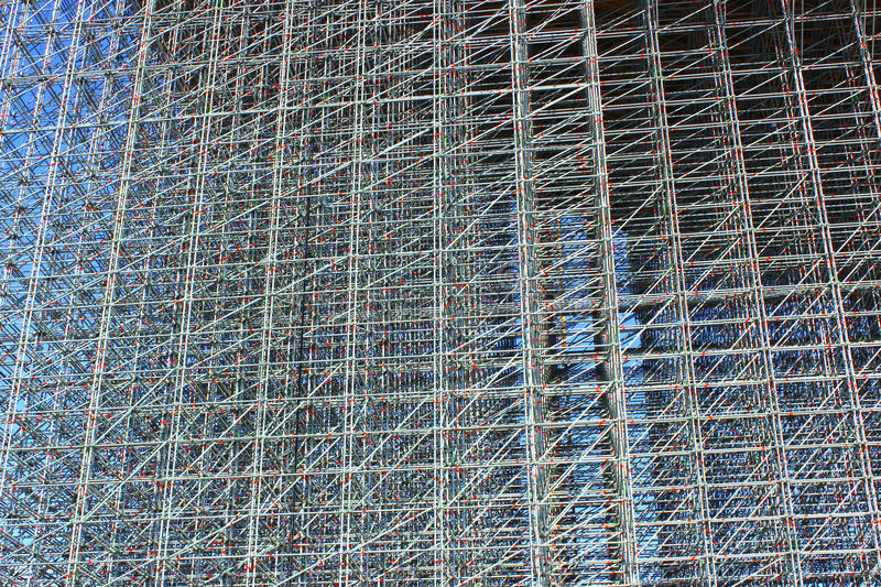 Background of the high-rise structure made of scaffolding royalty free stock photography