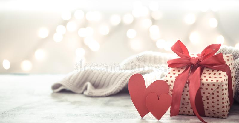 Background holiday, gift in a beautiful box with a heart. Valentine`s day. The concept of love and relationships stock image