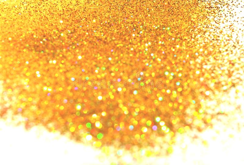 Background with holographic golden glitter sparkle on white stock image