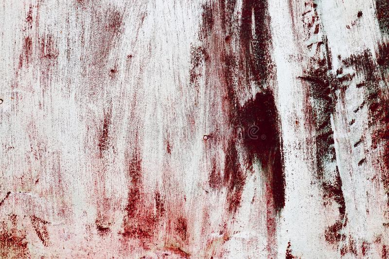 Background in horror style with texture of old rusty metal. A wall with imitation of smeared blood to Halloween royalty free stock photography