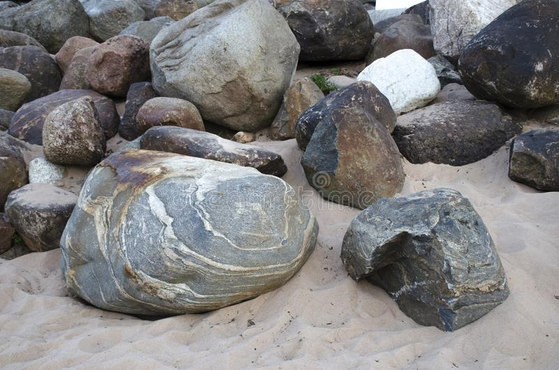 Background of huge gray stones with patterns. In the sand stock images