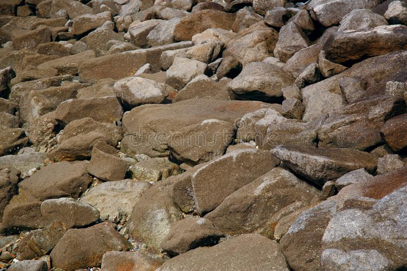 Background of huge stones on the coast of the Atlantic.  royalty free stock photos
