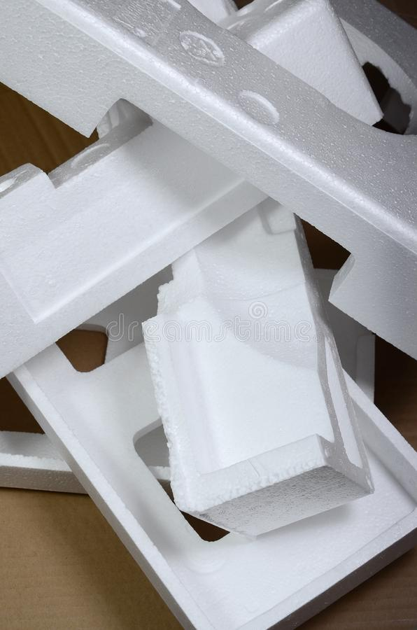 Background image with beige cardboard paper and styrofoam boxes disgarded as rubbish. The concept of unpacking new home appliance. S out of the carton box royalty free stock photos