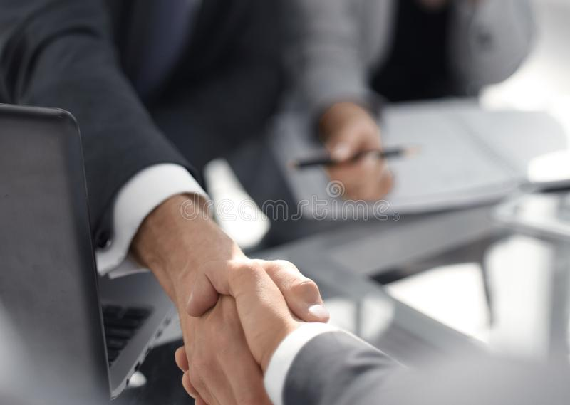 Background image of business handshake over the Desk. Business background royalty free stock photography
