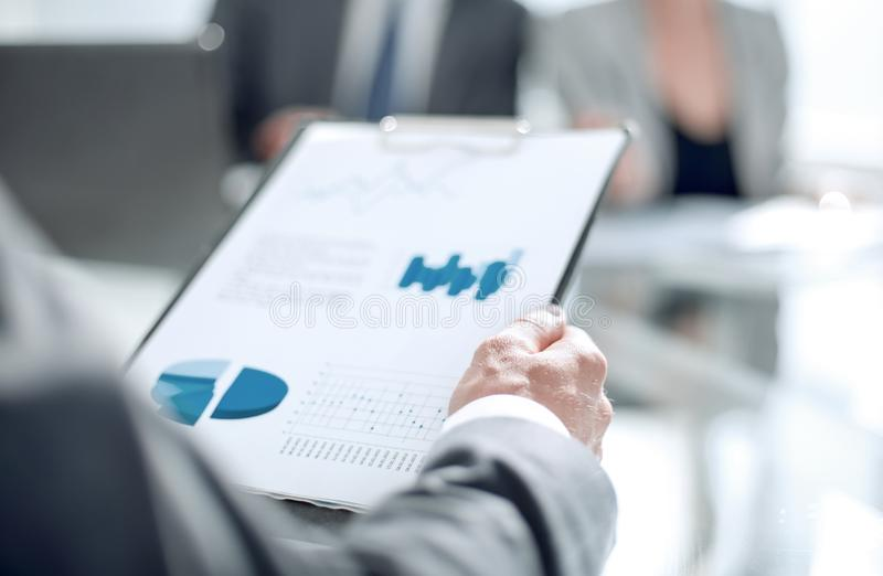 Background image of a businessman checking financial documents. stock photo