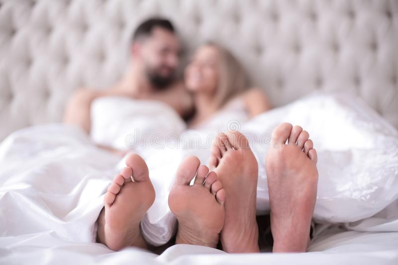 Background image of a couple in love lying on the bed stock images