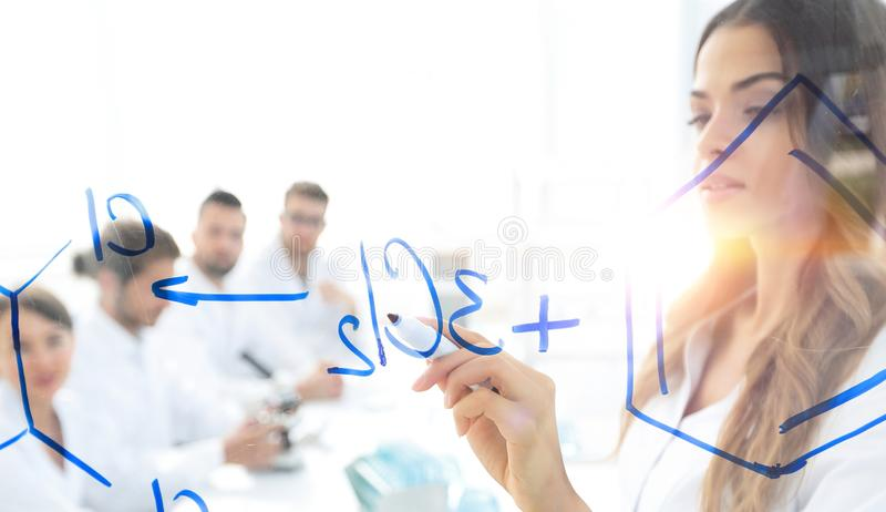 Female scientist makes a report to colleagues. Background image female scientist makes a report to colleagues stock images