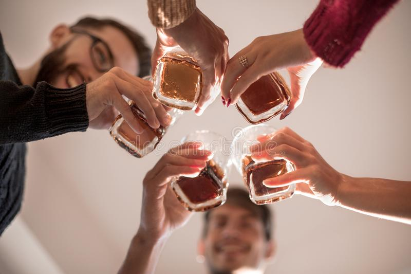 Background image of a glass of juice in the hands of the young couple royalty free stock images
