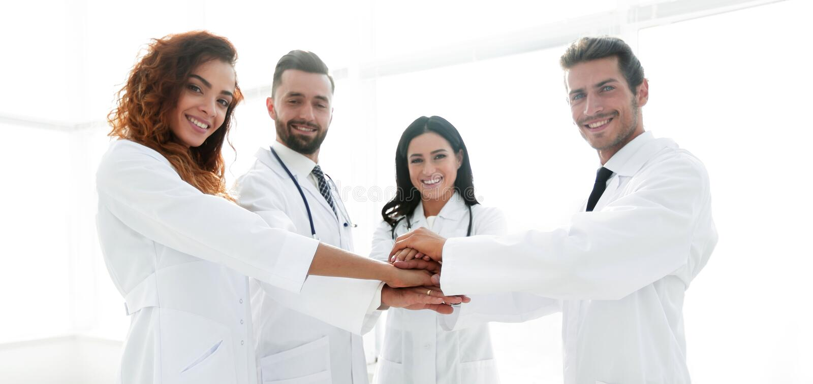 Background image of a group of doctors. The concept of teamwork stock photography