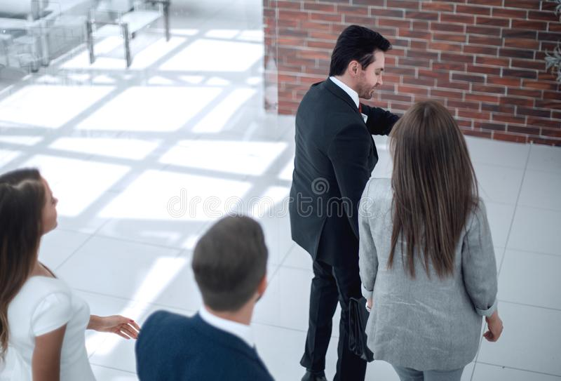 Background image.group of employees, late for work. Photo with copy space royalty free stock photography