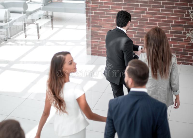 Background image.group of employees, late for work. Photo with copy space royalty free stock image