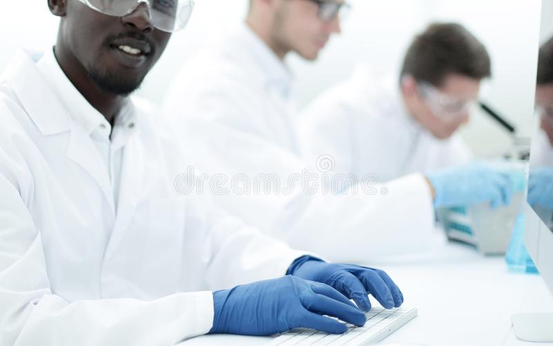 Background image of a group of scientists at the laboratory table. Photo with copy space stock images