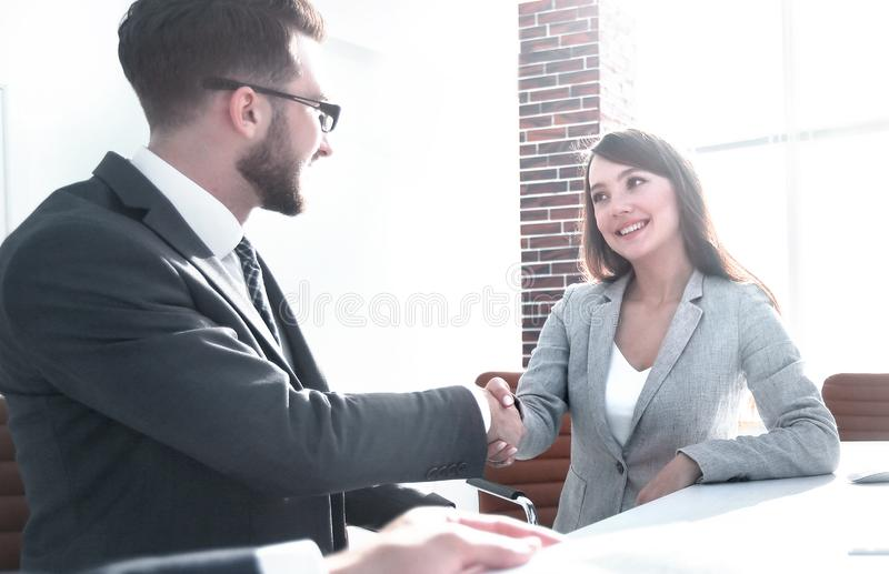 Background image . handshake of business partners. In the office.business concept stock photo