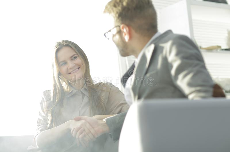 Background image of a handshake of colleagues in the workplace royalty free stock image