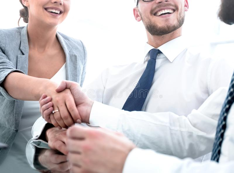 Background image.handshakes colleagues at the Desk royalty free stock photography