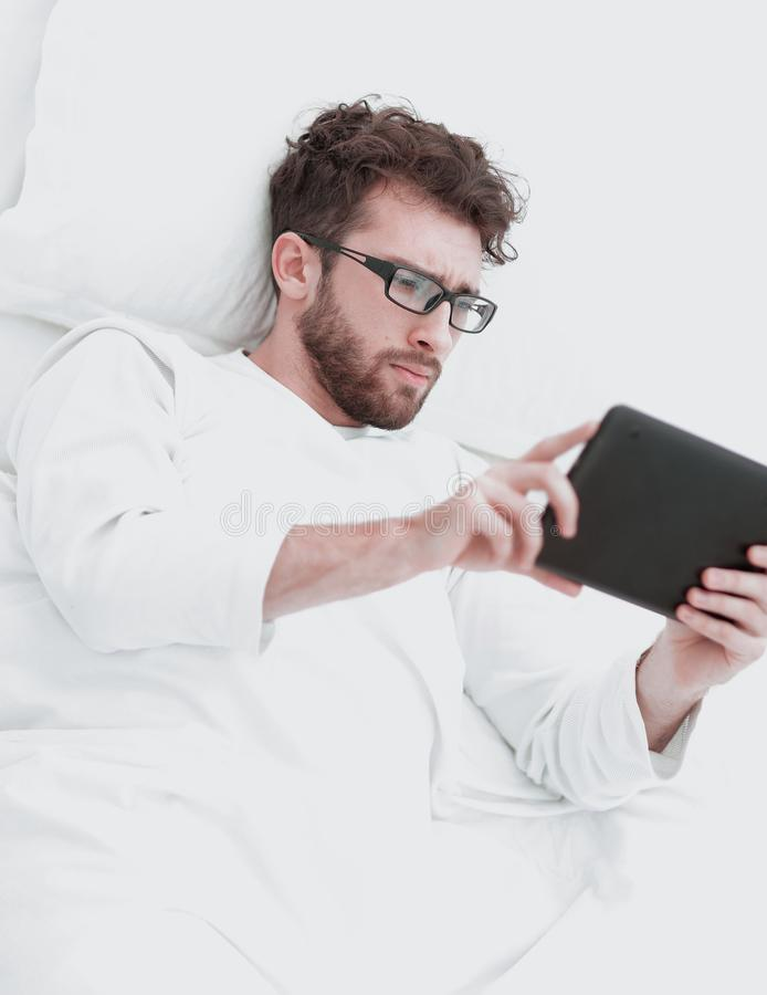 Background image . modern man reading on digital tablet. stock photography