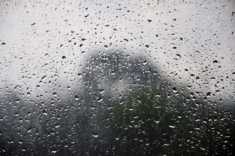 Background image of rain drops on a glass window. Macro photo with shallow depth of fiel royalty free stock image