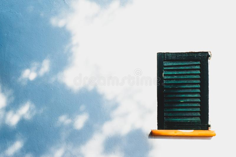Background Image of Rustic Window Shutter on Traditional Spani royalty free stock image