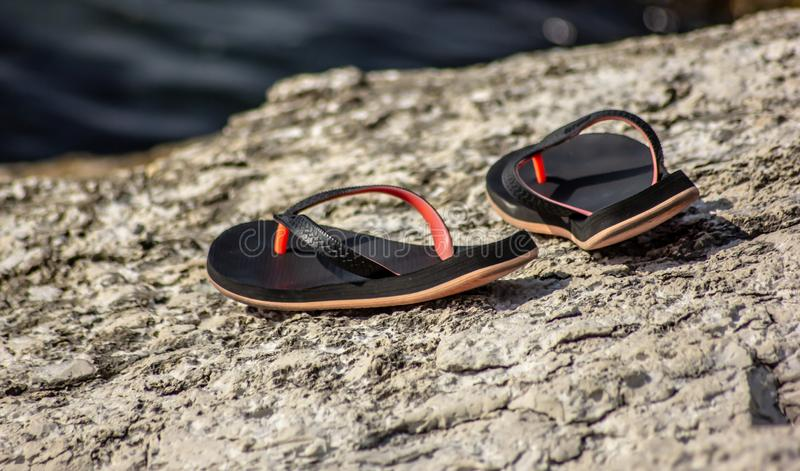 Background, image that shows two flip-flops resting on a rock. royalty free stock photography
